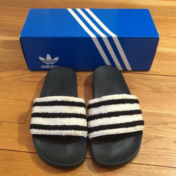 b95cf44b50ab59 adidas Shoes - adidas Originals Adilette Slides In White Black